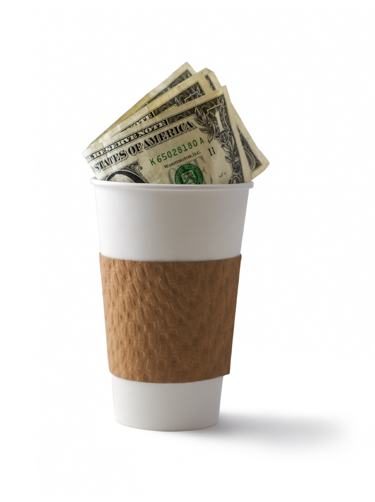 dollar bills in coffee cup