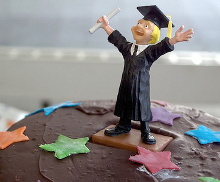 graduate cake topper, on top of cake with icing stars