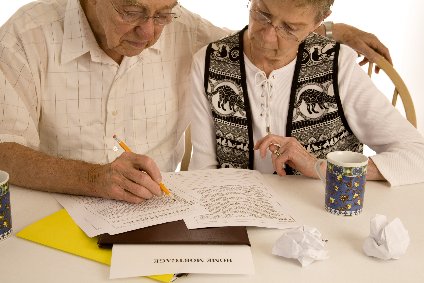 older couple filling out form