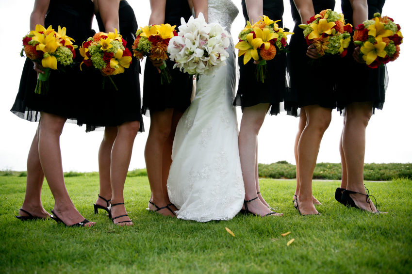 photo of bridesmaid and brides bouquets